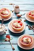 Pink grapefruits with yoghurt, granola and honey