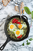 Green shakshuka with chard, tomatoes and bread