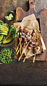 Lamb and rosemary skewers with charred lettuce and braised peas