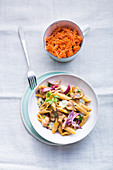 Penne in a creamy onion sauce with gorgonzola and mushrooms