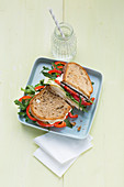 Double-decker cheese and pear sandwiches with peppers