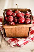 Fresh cherries in a wooden basket