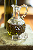 Olive oil in a glass carafe