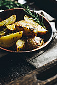 Baked potatoes with spices and rosemary
