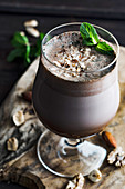 Cocoa smoothie with fresh mint and hazelnuts