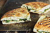 Grilled pide sandwich with spinach and camembert