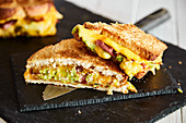 Grilled sandwiches with cheese, guacamole and bacon