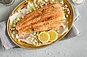 Oven-baked salmon with a cucumber and radish relish (seen from above)
