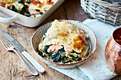 Spinach and salmon lasagne with a parmesan crust