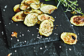 Courgette crisps with basil and rosemary