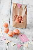 Apricot macaroons for Valentine's Day in a paper bag and in front of it