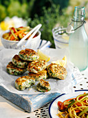 Grilled cakes with prawn, crab and spring onions served with egg noodle salad