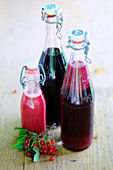 Homemade red currant juice in glass bottles