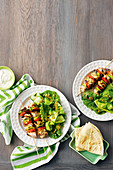 Greek salad and chicken skewers
