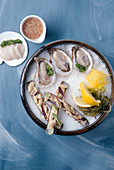 Oysters, razor clams and scallops with a side of mignonette sauce.