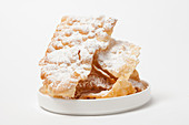 Fried pastries with powdered sugar (Italy)