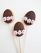 Three Decorated Easter Egg shaped cookies on a stick