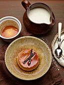 A dessert plate with creme caramel and cream