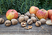 Apples and Walnuts on Wood Surface
