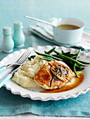 Roast turkey schnitzel with sage, lemon, mashed potatoes and green beans