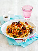 Spaghetti with spicy meatballs and red pesto