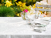 A place setting at a garden table