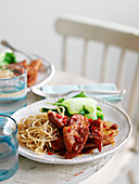 Sticky gammon steaks with noodles (England)