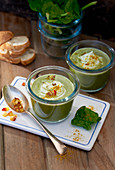 Spinach soup topped with apple in jars