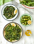 Steamed greens and mini courgette with lemon and olive oil