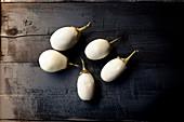Five white aubergines