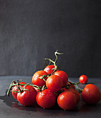Freshly Washed Vine Ripened Tomatoes in a Pile