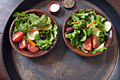 Dressed Leafy Green Salad in Wooden Bowls