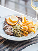 Fillet of Iberico pork with spinach migas and chips (Portugal)