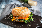 A green kale and grilled vegetable bagel