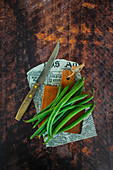 Fresh spring green beans on rustic table