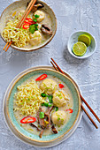 Thai soup with chow mein noodles fish pulp and chilli