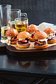 Chorizo and onion sliders with chimichurri aioli