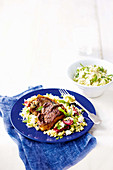 Peppered lamb chops with rhubarb and fetta couscous