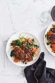 Barbecued lamb with warm barley and kale salad