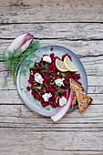 Beetroot tartare with purple chicory, dill, cream cheese and grilled bread