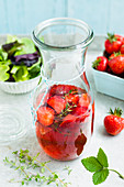 Homemade strawberry vinegar in a carafe