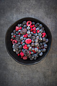 A bowl of frozen fruits of the forest