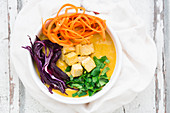 Turmeric curry with tofu, parsley, red cabbage and carrots