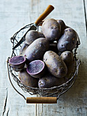 Blue potatoes in a wire basket