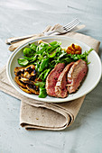 Beef with a herb salad and mushrooms (low carb)