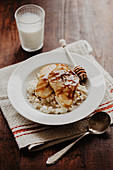 Rice pudding with pears, cinnamon, and maple syrup