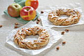 Pastry wreaths filled with apples and almonds, and dusted with powdered sugar (vegan)