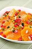 Oranges with pistachios, pine nuts and pomegranate seeds