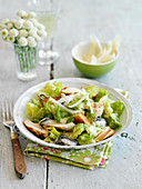 Caesar salad with chicken and croutons