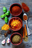Mixed Spices and Herbs over dark old wood. Food and cuisine ingredients